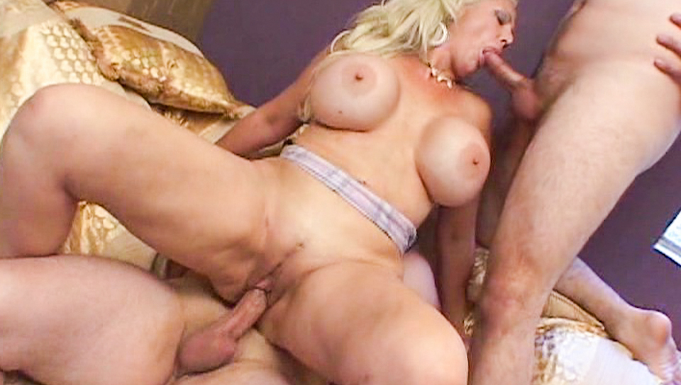 Blonde MILF takes on two cocks at a time and gets creamed !
