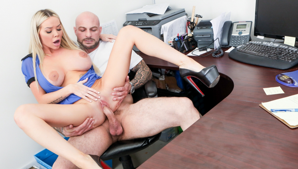 Blonde babe gets fucked by tattooed stud at the office