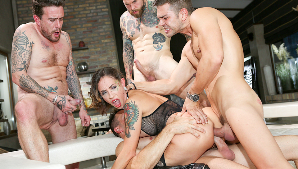Dirty tattooed MILF Malena gangbanged by four lucky studs.