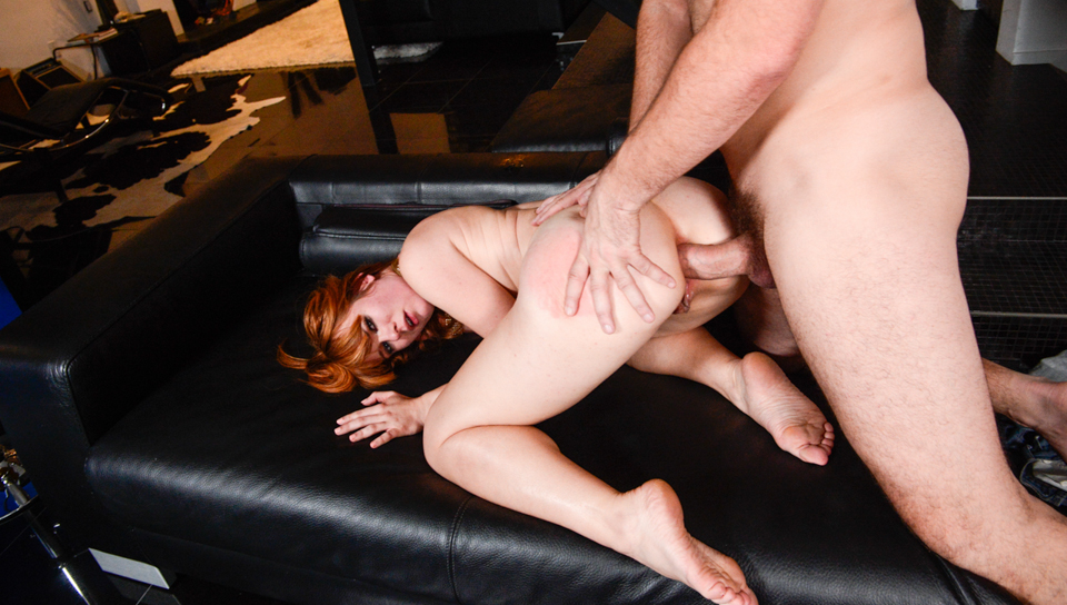 Horny redhead Claire Robbins receives a rough butt pounding