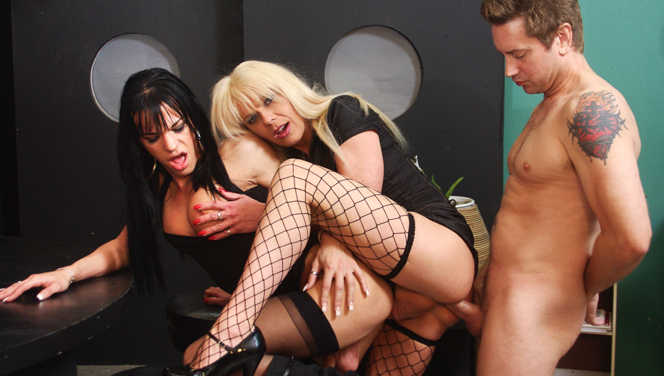 Two lustrous trannies take on a guy in this threesome action