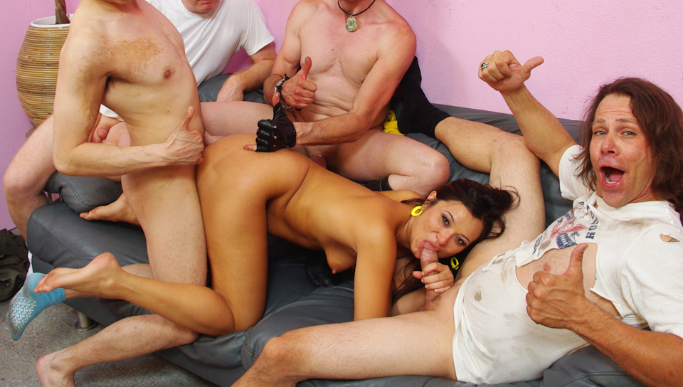 Brunette MILF receive a strange gang bang from homeless guys