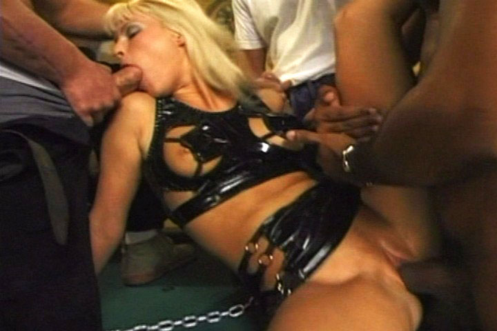 Babes in leather outfit spreading their pussies in this orgy