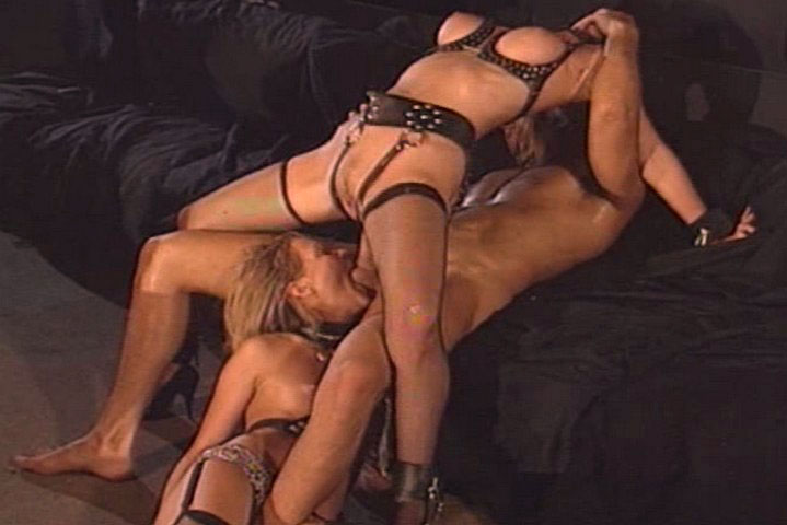 Rocco takes care of these 2 blondes wearing boundage