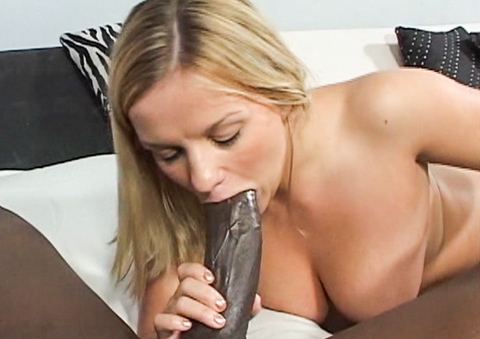 Horny blonde whore Caitlin swallows a massive black prick.