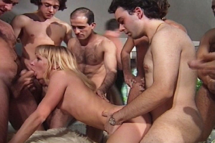 Horny blonde accepts doing an amazing gangbang with 14 men