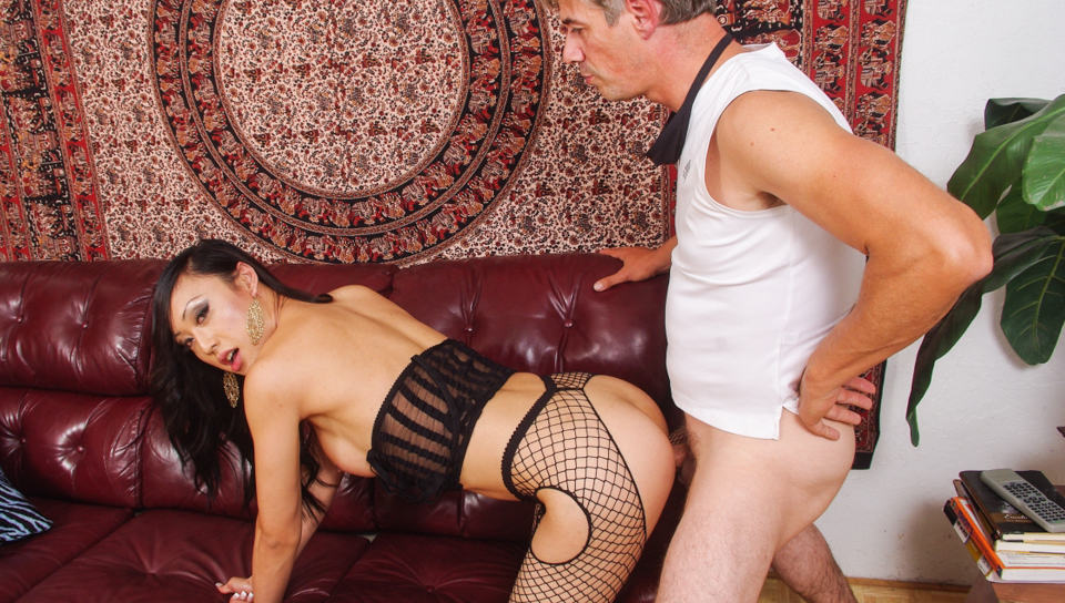 Asian shemale in sexy fishnets gets fucked in tight asshole.