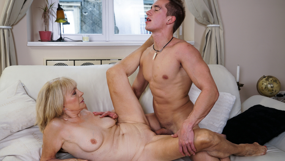 Vigorous young man likes to fuck lusty blonde granny.