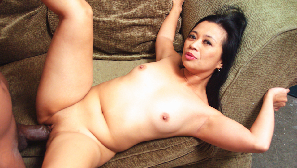 A horny Asian lady gets her pussy filled with big black cock