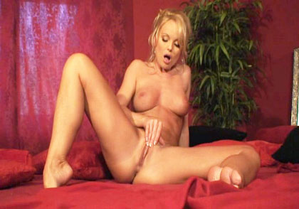 Silvia Saint strips for you on a luxurious red velvet bed!