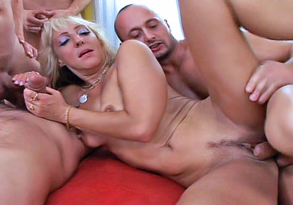 Blonde MILF caught in a hot gangbang of 4 men with big dicks