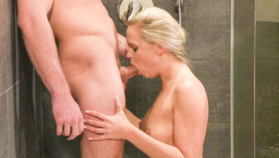 Beautiful blonde blows some guy's big cock while in shower.
