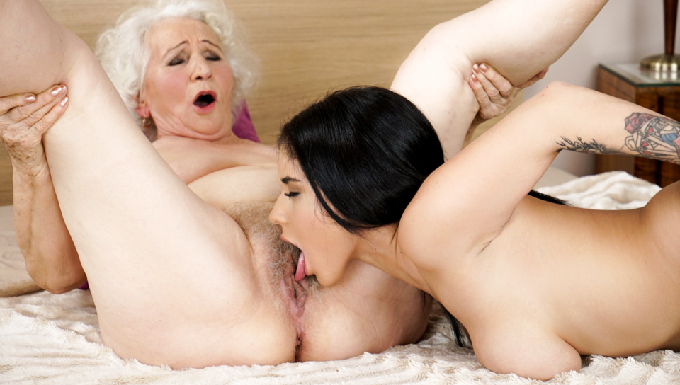 Granny gets her hairy pussy licked by hot younger lesbian