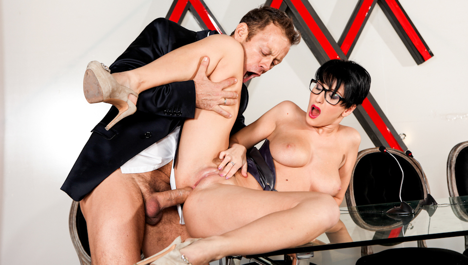 Sexy bitch with glasses blows and rides Rocco's massive dick