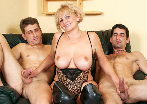An old granny is getting double penetrated by 2 young cocks!