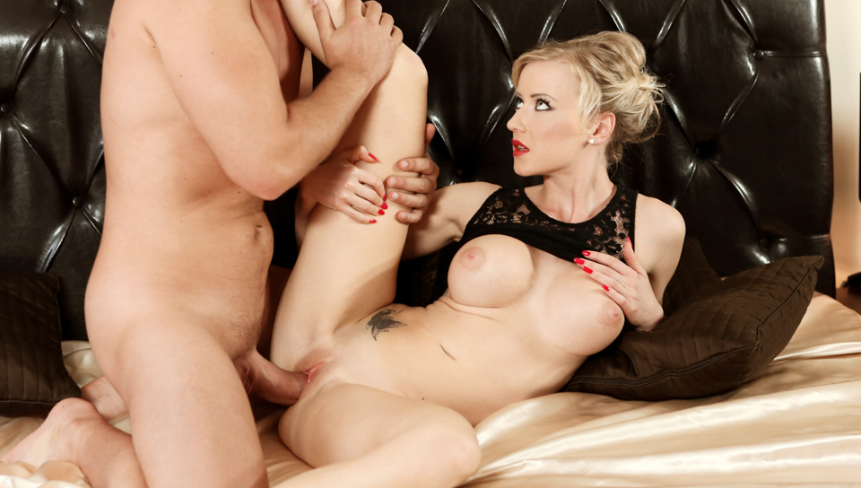 Sexy blonde beauty has her tight pussy pounded by hard cock.