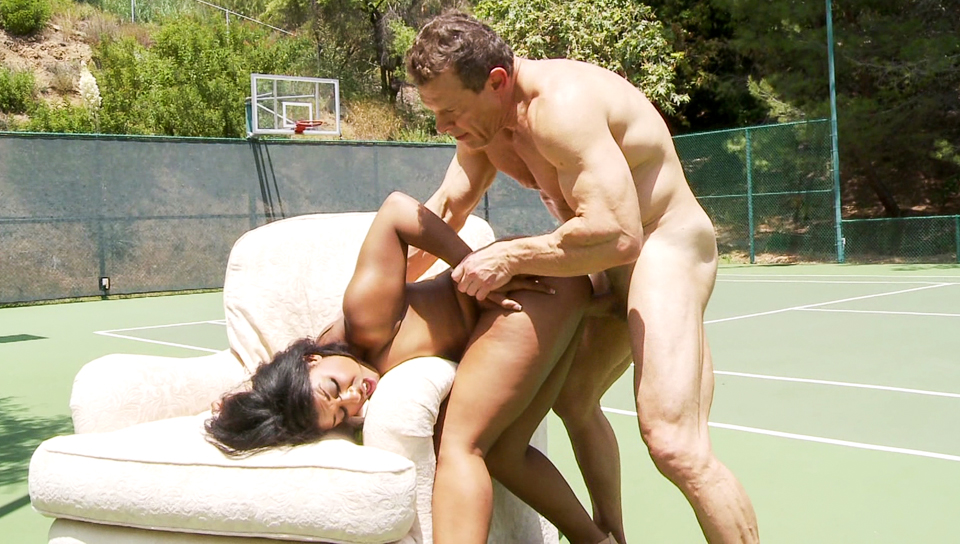 Slutty ebony Megan Vaughn is fucked in a basketball court.