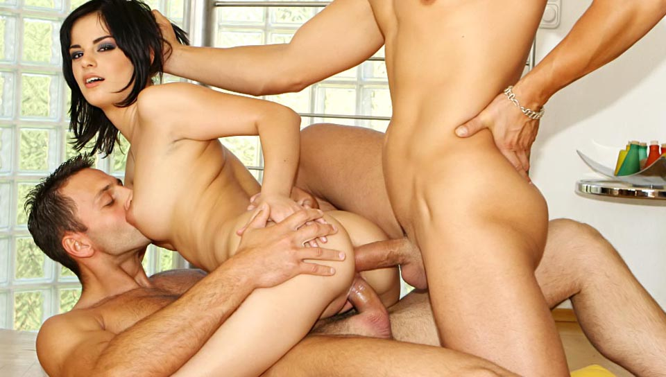 Sexy tight ass slut Black Angelica takes on 3 hard cocks in all her holes!