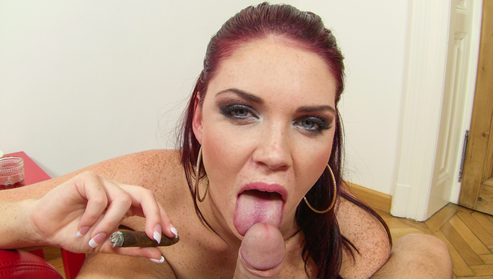 Lovely redhead Emma Leigh strokes cock with mouth and boobs.