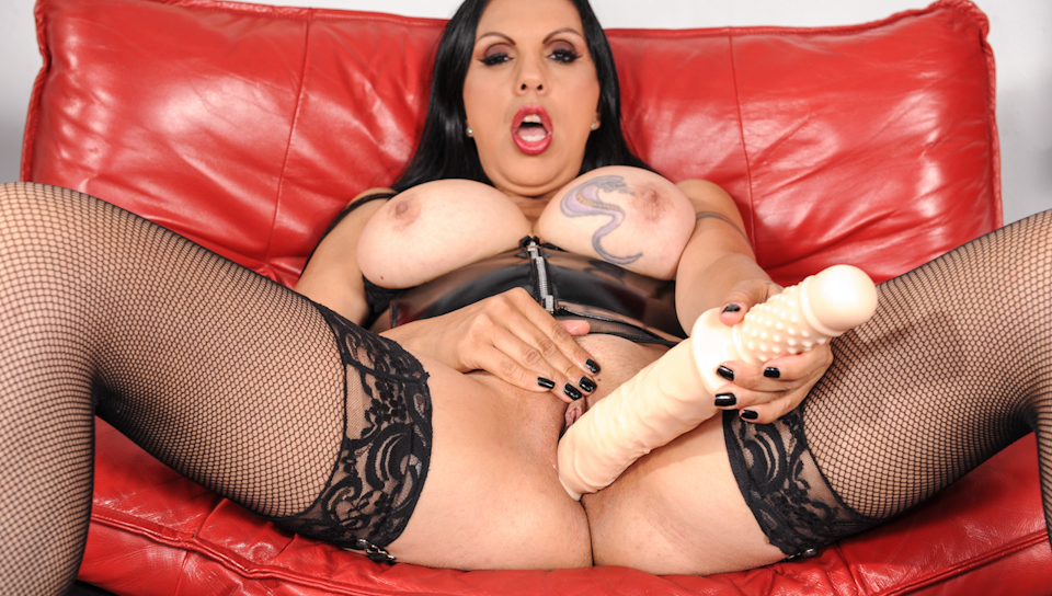 Watch mature Angela stuffing her snatch with a big big toy