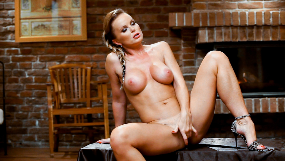 Silvia Saint masturbates alone in front of the fire place!