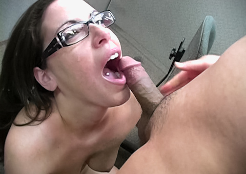 A cute brunette with glasses sucks cock at the office 