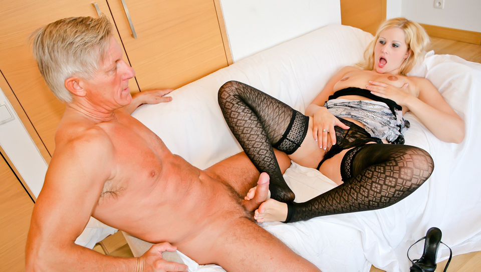Sexy blonde foot fucks big cock, ready to fuck her tight ass