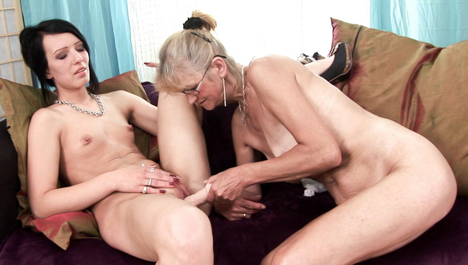 Older lady fucks young girl with a dildo in her tight pussy.