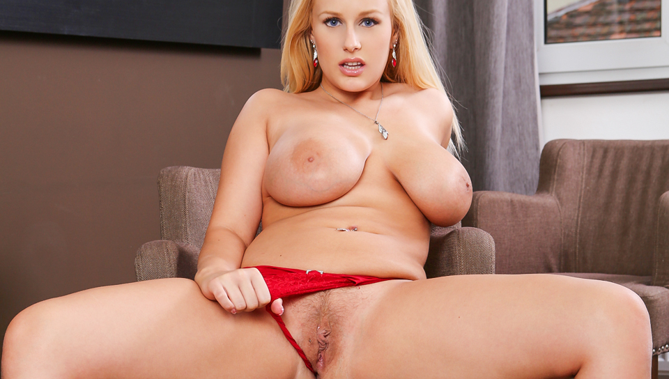 Sexy Angel Wicky in red underwear fingers her wet pussy.