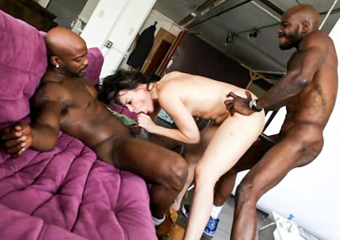Horny cunt is double penetrated by two massive black cocks.
