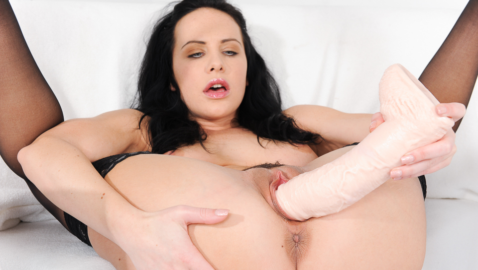 Horny dark haired bitch plays with gigantic colored toys!