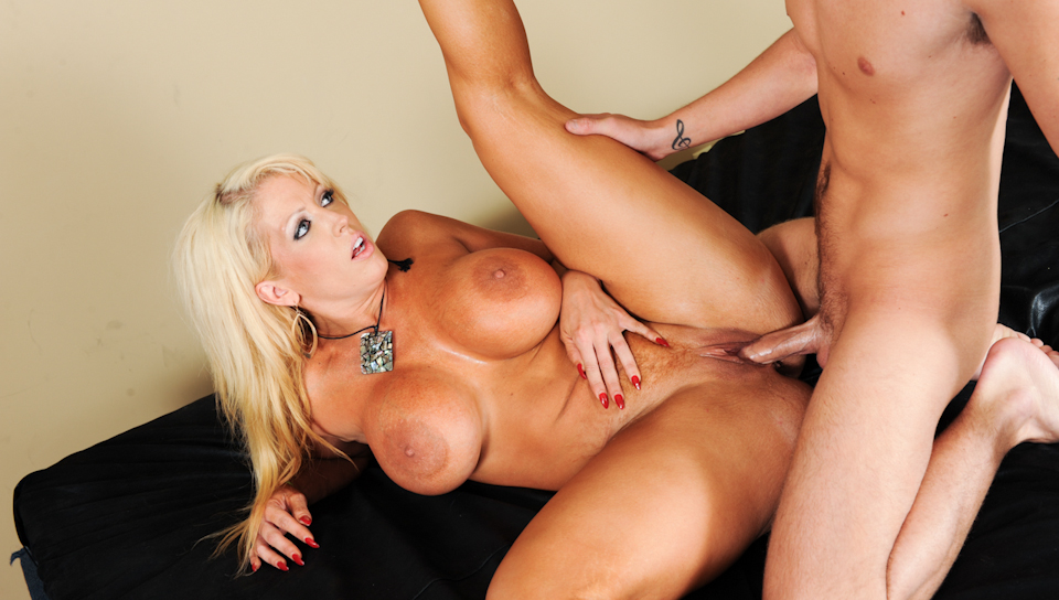 This blonde milf with huge boobs gets in the bed for sex!