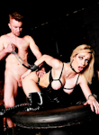 The art of control. Nasty blonde in black latex garments gets