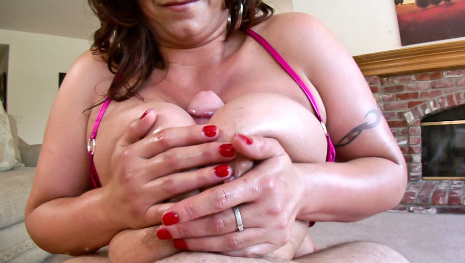 Big boobed mature brunette juggfucking big cock with lube