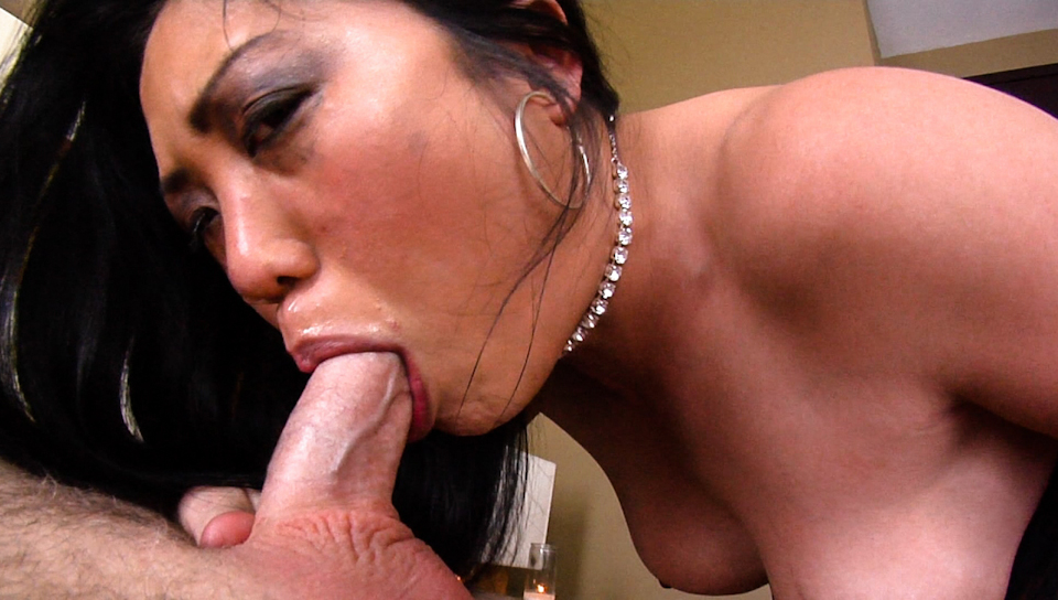This Asian girl enjoys having big male rods down her throat!