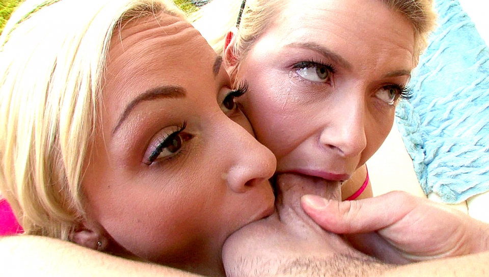 Two beautiful blondes suck every inch of Mike Adrianos cock